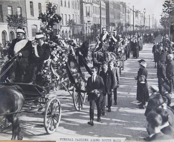 The funeral procession passing along the South Mall in Cork.