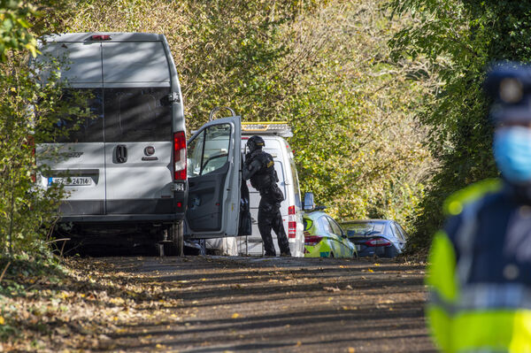 A Garda on duty as members of the Armed Response Unit attend the scene. Picture: Dan Linehan