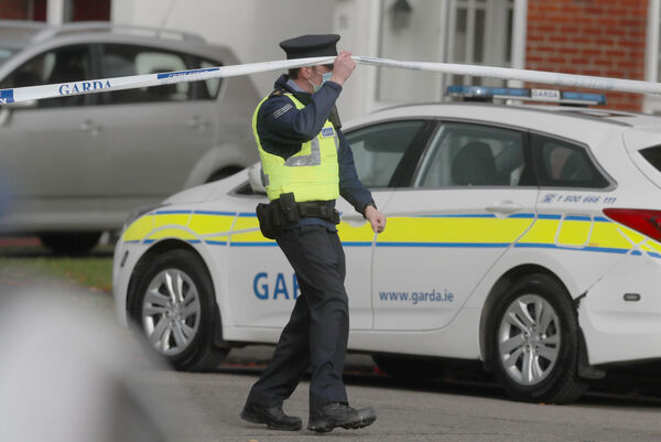 Gardai at house Llewellyn estate in Ballinteer, south Dublin, following the discovery of bodies of a woman and two young children. Picture: Brian Lawless/PA Wire