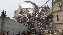 87 killed as building collapses
