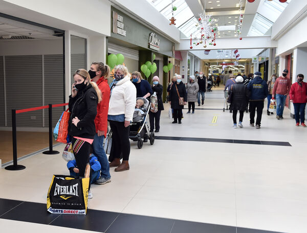 Queues at Douglas Village Shopping centre which has re-opened