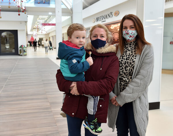 Julie Campell and her son Flynn McCarthy and her sister Christine Keohane at Douglas Village Shopping centre which has re-opened