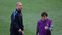 Pep Guardiola and Lionel Messi File Photo