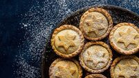 Traditional British Christmas Pastry Dessert Home Baked Mince Pies with Apple Raisins Nuts Filling Golden Shortcrust Powdered on