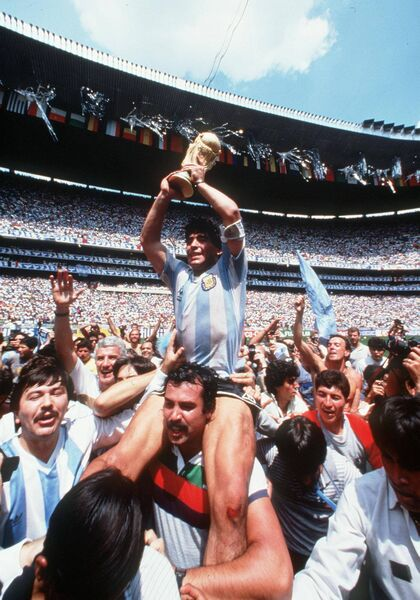 Diego Maradona celebrates World Cup victory in 1986 with Argentina fans. Picture: INPHO/Billy Stickland