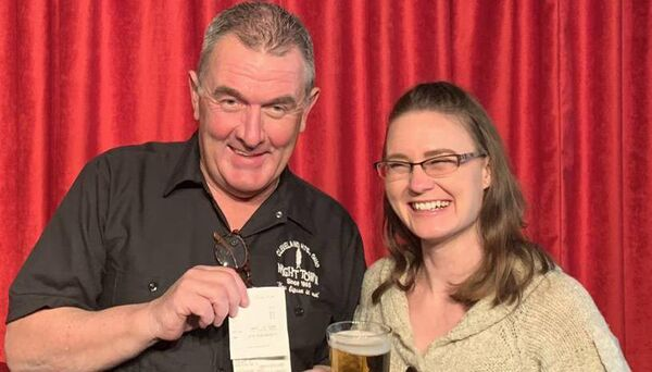 Cahersiveen native Brendan Ring, owner of the Nighttime restaurant and jazz club in Cleveland, Ohio, and waitress Heather Sandow with the whopping $3,000 tip for a pint of Stella left by a customer on Sunday. Picture: Aoifeoregan