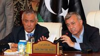 Libyan PM, freed from abduction, appeals for calm