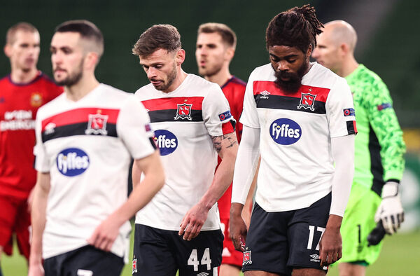 Dundalk's Andy Boyle and Nathan Oduwa dejected after the game. Picture: INPHO/Tommy Dickson