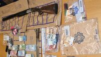 Two men and two women arrested following seizure of cash, drugs and shotgun