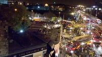 32 injured as police helicopter crashes into pub