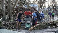 Philippines typhoon kills at least 100 as it heads for Vietnam