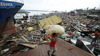 Typhoon aid slowed by massive devastation