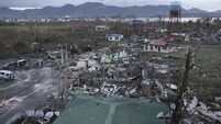 Typhoon 'kills 10,000 in one city'