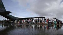 Eight killed in typhoon food crush as relief efforts intensify