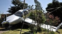Airplane crash-lands in back garden
