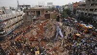 20 rescued and 10 dead following hotel collapse in India