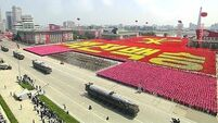 In Pictures: North Korea marks anniversary with massive military parade