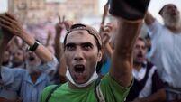 Tear gas and gunfire as Egyptian forces move to clear protest camps