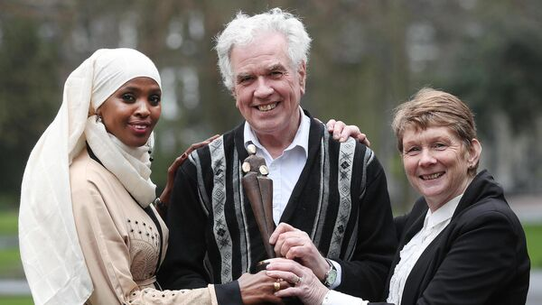 Ifrah Ahmed with Fr Peter McVerry and Catherine Corless in 2018 when she received the International Person of the Year Award at the Rehab awards. Picture: Robbie Reynolds