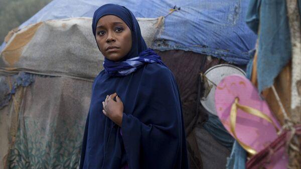 Aja Naomi King as Ifrah Ahmed in A Girl From Mogadishu.