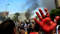 Deaths in Cairo street clashes as Egypt moves to clear protests