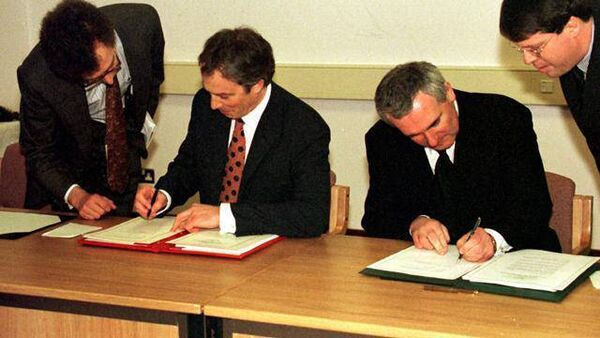 Then Prime Minister Tony Blair and the Taoiseach Bertie Ahern sign the Good Friday Agreement.