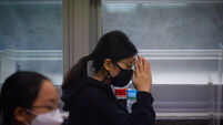 South Korea holds national university entrance exam amid rising Covid infections