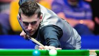 World number one Selby bows out to emotional Hawkins