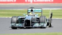 Rosberg wins dramatic British GP after tyres burst on four cars