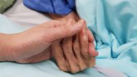 Holding grandmother's hand in the nursing care. Showing all love, empathy, helping and encouragement : healthcare in end of life