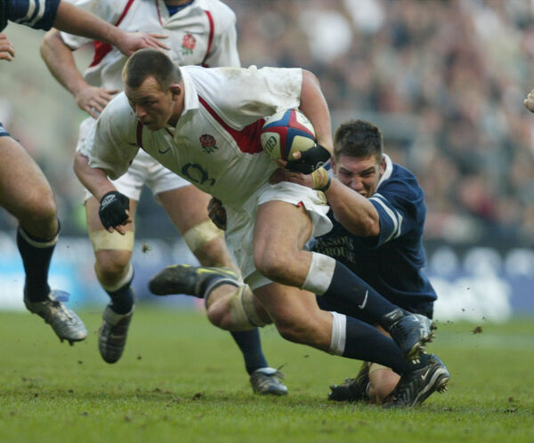 England's Steve Thompson is tackled by Scotland's Ross Beattie, during the 2003 Six Nations. He revealed this week that at 42 has early-onset dementia. Picture: Tom Hevezi.