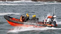 Coast Guard ask for RNLI help for first time since service suspends boat operations over life jacket concerns