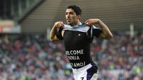 Suarez marks Reds return with double against Sunderland