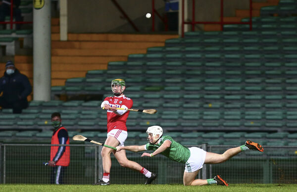 Cork's Brian Roche shoots under pressure from Limerick's Jimmy Quilty. Picture: INPHO/Ken Sutton
