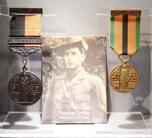 Medals and a photo of former Spike Island internee Thomas Griffin, of Ballynoe, Co Cork. (left) War of Independence Service Medal with 'Comrac' bar (issued in 1941) and (right) The Truce Commemorative Medal (issued in 1971) Picture: Larry Cummins