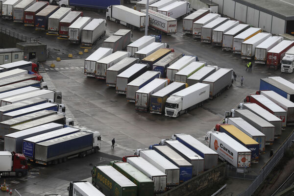 Trucks waiting to get out of Britain backed up for miles and people were left stranded at airports as dozens of countries around the world slapped tough travel restrictions on the U.K. because of a new and seemingly more contagious strain of the coronavirus in England. Picture: AP Photo/Kirsty Wigglesworth