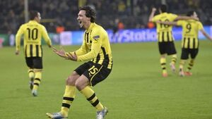 Crazy finish sees Dortmund make it to the semis