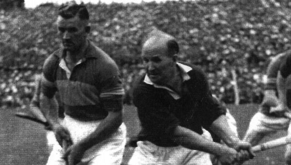 Theo English lines up for a throw in with Cork's Christy Ring