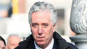Judge recommends second           independent person to help examine FAI files seized by ODCE