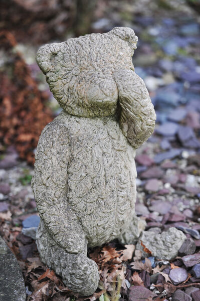 A stone Teddy wiping a tear from its eye is placed near a remembrance plaque and sculpture dedicated to babies who died at Bessborough. Picture: Larry Cummins