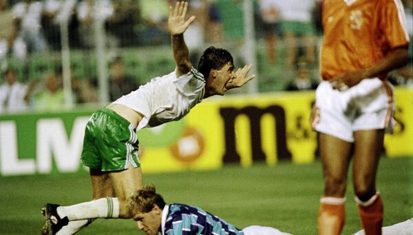 Niall Quinn celebrates scoring againts the Netherlands in Palermo at Italia '90