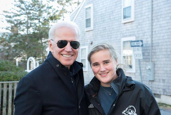 Maisy Biden with her grandfather on a family trip to Nantucket. Picture: The Boston Globe.