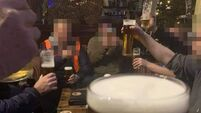 Men pictured drinking pints at UK hotel with caption 'What Lockdown?'
