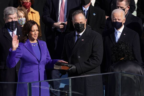 Kamala Harris is sworn as U.S. Vice President by U.S. Supreme Court Associate Justice Sonia Sotomayor as her husband Doug Emhoff looks. Picture: Alex Wong/Getty Images