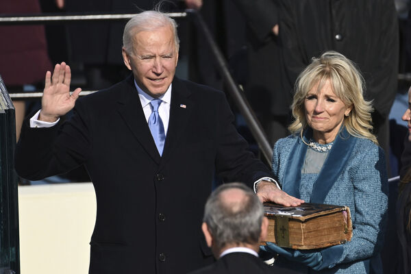 Joe Biden is sworn in as the 46th president of the United States by Chief Justice John Roberts as Jill Biden holds the Bible during the 59th Presidential Inauguration at the U.S. Capitol in Washington, Wednesday, Jan. 20, 2021. Picture: Saul Loeb/Pool Photo via AP