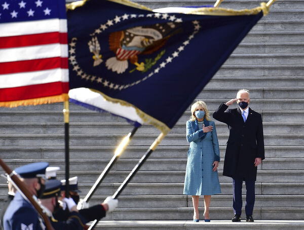 President Joe Biden salutes as his wife Jill puts her hand over her heart as they review the troops from the steps of the U.S. Capitol during the inauguration, Wednesday, Jan. 20, 2021, in Washington. Picture: David Tulis/Pool Photo via AP