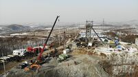 Reaching trapped China mine workers 'will take at least 15 days'