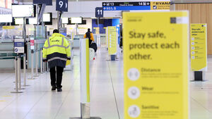 Gardaí lack the powers to hold people at airport, says Coveney