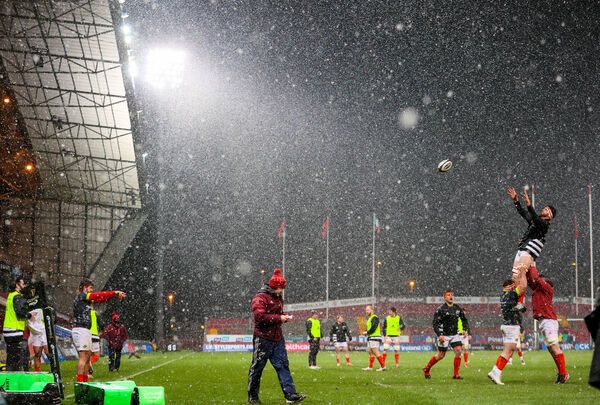 The Munster forwards warm-up in the snow. Picture: INPHO/Dan Sheridan