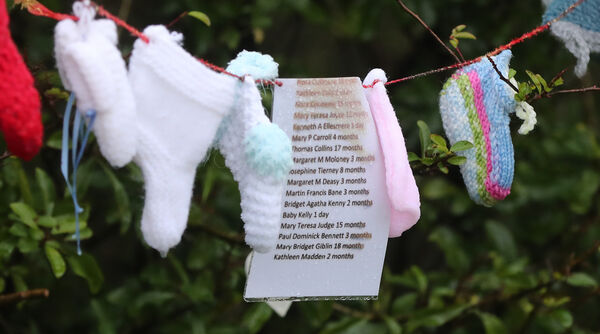 Lists of the names of dead children at the grotto on an unmarked mass grave at the site of the Tuam Mother and Baby Home run by the Bon Secures sisters. Picture: Niall Carson/PA Wire